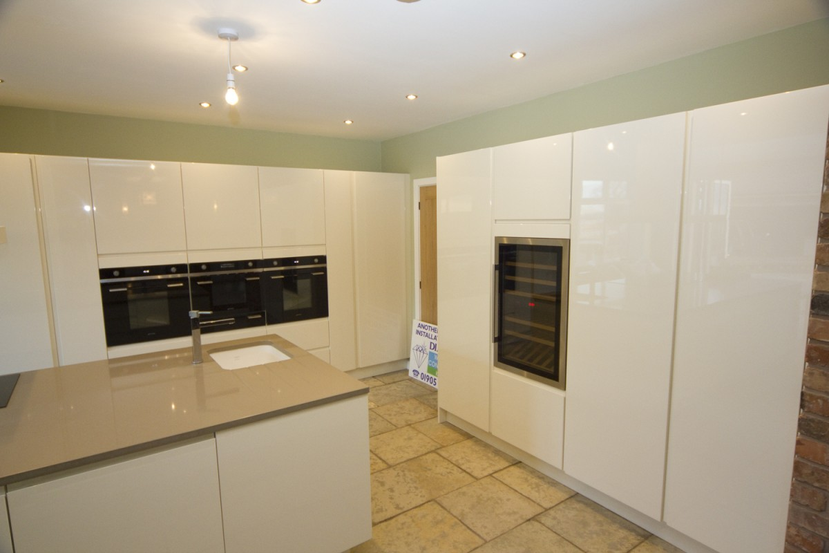 Contemporary White Kitchen With Grey Marble Worktops West