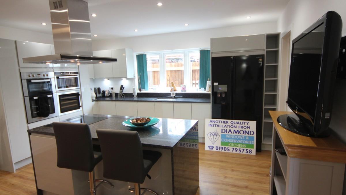 White Gloss Kitchen With Black Worktop