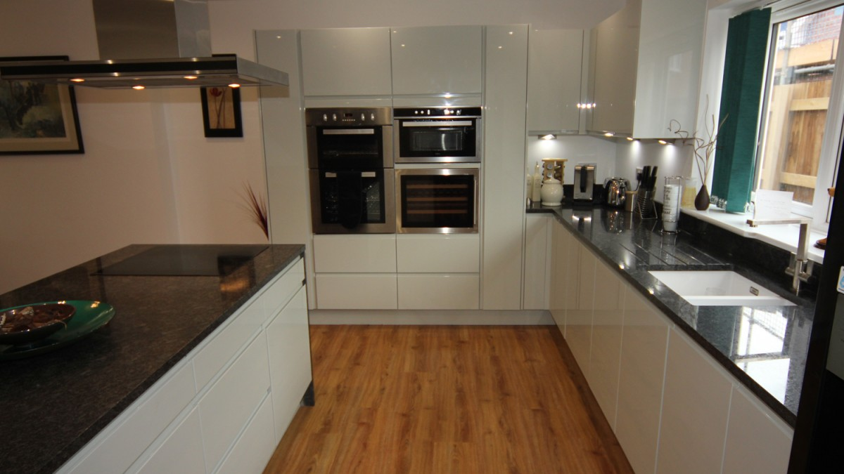 Black Gloss Kitchen With Oak Worktops