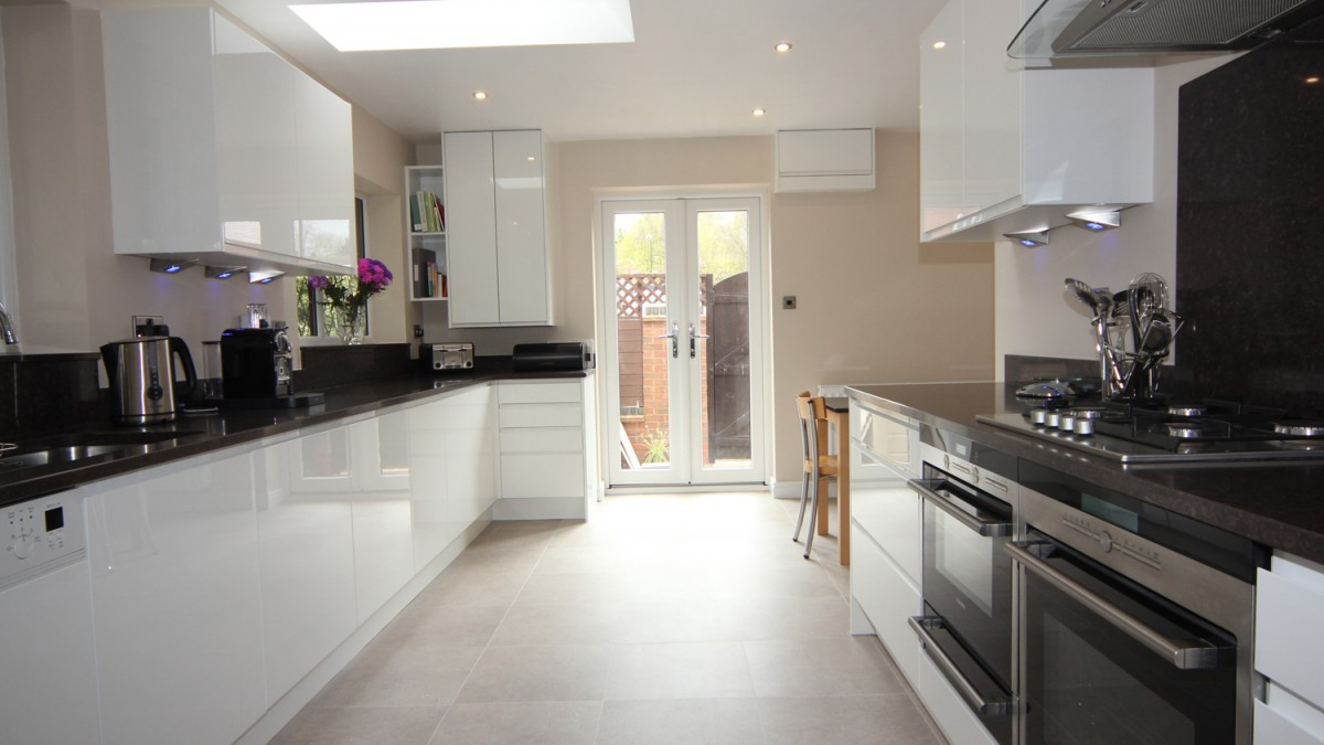 White Gloss Finish Cupboards With Dark Granite Effect
